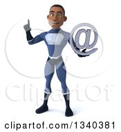 Clipart Of A 3d Young Black Male Super Hero Dark Blue Suit Holding Up A Finger And An Email Arobase At Symbol Royalty Free Illustration