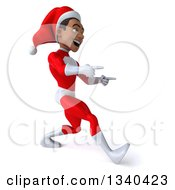 Clipart Of A 3d Young Black Male Christmas Super Hero Santa Walking And Pointing To The Right Royalty Free Illustration by Julos