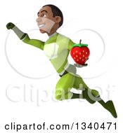 Clipart Of A 3d Young Black Male Super Hero In A Green Suit Holding A Strawberry And Flying Royalty Free Illustration