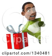 Clipart Of A 3d Young Black Male Super Hero In A Green Suit Holding A Gift And Looking Around A Sign Royalty Free Illustration
