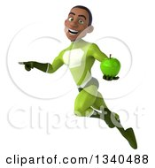 Clipart Of A 3d Young Black Male Super Hero In A Green Suit Holding A Green Apple Pointing And Flying Royalty Free Illustration