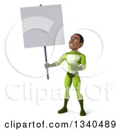 Clipart Of A 3d Young Black Male Super Hero In A Green Suit Holding And Pointing To A Blank Sign Royalty Free Illustration
