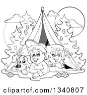 Lineart Clipart Of A Cartoon Black And White Dog Boy And Girl Resting In A Tent While Camping Royalty Free Outline Vector Illustration