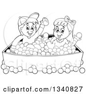 Lineart Clipart Of A Cartoon Black And White Boy And Girl Playing In A Ball Pit Royalty Free Outline Vector Illustration by visekart