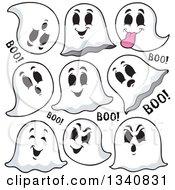 Clipart Of Cartoon Halloween Ghosts Saying Boo Royalty Free Vector Illustration