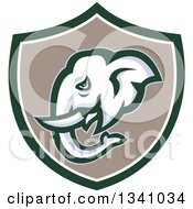 Clipart Of A Retro Elephant Head In A Green White And Taupe Shield Royalty Free Vector Illustration