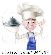 Clipart Of A Happy Young White Male Chef Gesturing Ok And Holding A Cloche Platter Royalty Free Vector Illustration