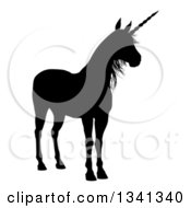 Clipart Of A Black Silhouetted Unicorn Royalty Free Vector Illustration by AtStockIllustration