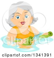 Happy Senior White Woman Swimming With Pool Noodles