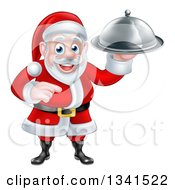 Clipart Of A Happy Christmas Santa Claus Chef Holding A Silver Cloche Platter And Pointing Royalty Free Vector Illustration