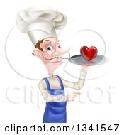 Clipart Of A White Male Chef With A Curling Mustache Holding A Heart On A Tray And Pointing Royalty Free Vector Illustration