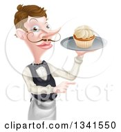 Cartoon Caucasian Male Waiter With A Curling Mustache Pointing And Holding A Cupcake On A Tray