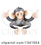 Clipart Of A Cartoon Black And Tan Happy Baby Chimpanzee Monkey Giving A Thumb Up And Pointing Royalty Free Vector Illustration by AtStockIllustration
