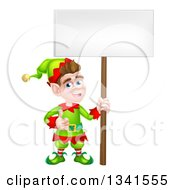 Clipart Of A Cartoon Happy Male Christmas Elf Giving A Thumb Up And Holding A Blank Sign Royalty Free Vector Illustration by AtStockIllustration