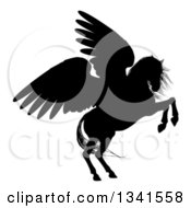 Clipart Of A Black Silhouette Of A Rearing Winged Pegasus Horse 2 Royalty Free Vector Illustration by AtStockIllustration