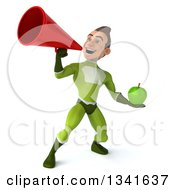 Clipart Of A 3d Young White Male Super Hero In A Green Suit Holding An Apple And Announcing With A Megaphone Royalty Free Illustration