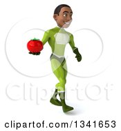 Clipart Of A 3d Young Black Male Super Hero In A Green Suit Holding A Tomato And Walking Slightly To The Right Royalty Free Illustration