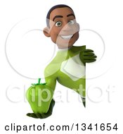Clipart Of A 3d Young Black Male Super Hero In A Green Suit Holding A Green Bell Pepper Around A Sign Royalty Free Illustration
