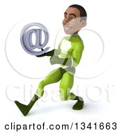 Clipart Of A 3d Young Black Male Super Hero In A Green Suit Holding An Email Arobase At Symbol And Speed Walking To The Left Royalty Free Illustration