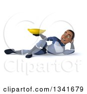 Clipart Of A 3d Young Black Male Super Hero Dark Blue Suit Holding A Banana And Resting On His Side Royalty Free Illustration