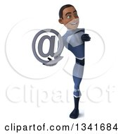Clipart Of A 3d Full Length Young Black Male Super Hero Dark Blue Suit Holding An Email Arobase At Symbol And Looking Around A Sign Royalty Free Illustration