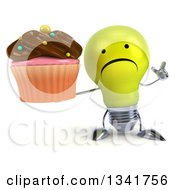 Clipart Of A 3d Unhappy Yellow Light Bulb Character Holding Up A Finger And A Chocolate Frosted Cupcake Royalty Free Illustration