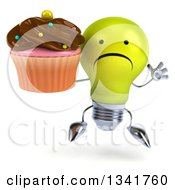 Clipart Of A 3d Unhappy Yellow Light Bulb Character Jumping And Holding A Chocolate Frosted Cupcake Royalty Free Illustration