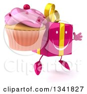 Clipart Of A 3d Happy Pink Gift Character Holding A Cupcake Facing Slightly Right And Jumping Royalty Free Illustration