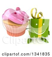Clipart Of A 3d Happy Green Gift Character Holding Up A Pink Frosted Cupcake Royalty Free Illustration