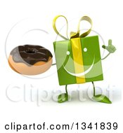 Clipart Of A 3d Happy Green Gift Character Holding Up A Finger And A Chocolate Glazed Donut Royalty Free Illustration