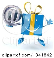 Clipart Of A 3d Happy Blue Gift Character Holding An Email Arobase At Symbol And Jumping Royalty Free Illustration by Julos