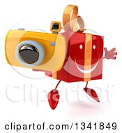 Clipart Of A 3d Happy Red Gift Character Holding A Camera Facing Slightly Right And Jumping Royalty Free Illustration by Julos