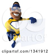Clipart Of A 3d Muscular Black Male Super Hero In A Yellow And Blue Suit Holding Up And Pointing To A Blank Sign Royalty Free Illustration