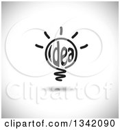 Clipart Of A Black Idea Text Shining Light Bulb Over Shading Royalty Free Vector Illustration