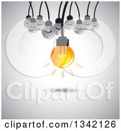 Clipart Of A Suspended Idea Light Bulb And Plain Bulbs Over Shading Royalty Free Vector Illustration