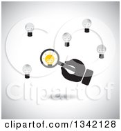 Clipart Of A Hand Holding A Magnifying Glass Over A Unique Light Bulb Over Shading Royalty Free Vector Illustration