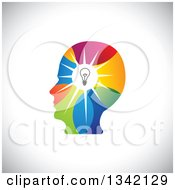 Clipart Of A Colorful Human Head Silhouette With A Shining Light Bulb Over Shading Royalty Free Vector Illustration