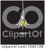 Clipart Of A Suspended White And Yellow Idea Text Light Bulb On Black Royalty Free Vector Illustration