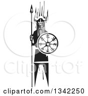 Clipart Of A Black And White Woodcut Viking Holding A Mystic Wheel Shield And Spear Royalty Free Vector Illustration