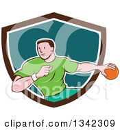Clipart Of A Retro Cartoon Male Handball Player In Action Emerging From A Brown White And Teal Shield Royalty Free Vector Illustration