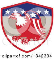 Clipart Of A Retro Cartoon American Bald Eagle With A Patriotic Wing In A Red Tan Blue And White Shield Royalty Free Vector Illustration