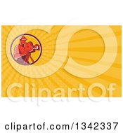 Clipart Of A Retro Male Cameraman Filming In A Circle And Yellow Rays Background Or Business Card Design Royalty Free Illustration