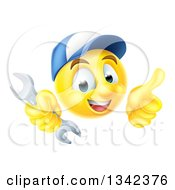 Cartoon Yellow Emoji Emoticon Plumber Or Mechanic Wearing A Baseball Cap Holding A Wrench And Giving A T Humb Up