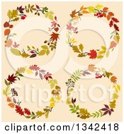 Clipart Of Colorful Autumn Leaf Wreaths 4 Royalty Free Vector Illustration
