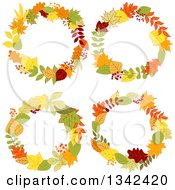 Clipart Of Colorful Autumn Leaf Wreaths 2 Royalty Free Vector Illustration
