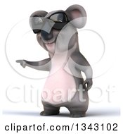 Clipart Of A 3d Koala Wearing Sunglasses And Pointing To The Left Royalty Free Illustration