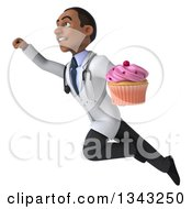 Clipart Of A 3d Young Black Male Nutritionist Doctor Holding A Pink Frosted Cupcake And Flying Up To The Left Royalty Free Illustration