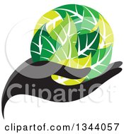Black Hand Holding A Globe Of Green Leaves