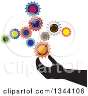 Clipart Of A Black Silhouetted Hand Creating Something With Colorful Gear Cog Wheels Royalty Free Vector Illustration by ColorMagic
