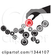 Clipart Of A Black Silhouetted Hand Creating Something With Black And Red Gear Cog Wheels Royalty Free Vector Illustration by ColorMagic